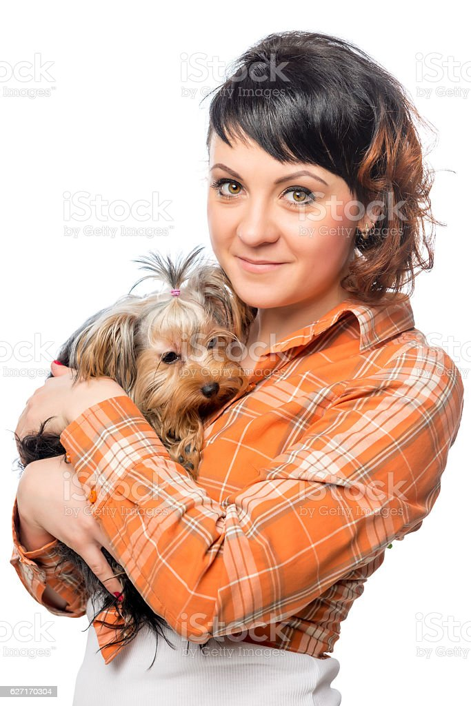 Vertical portrait of a beautiful girl with a small dog stock photo