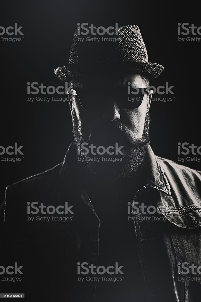 Vertical portrait of a hipster with a pork pie hat stock photo