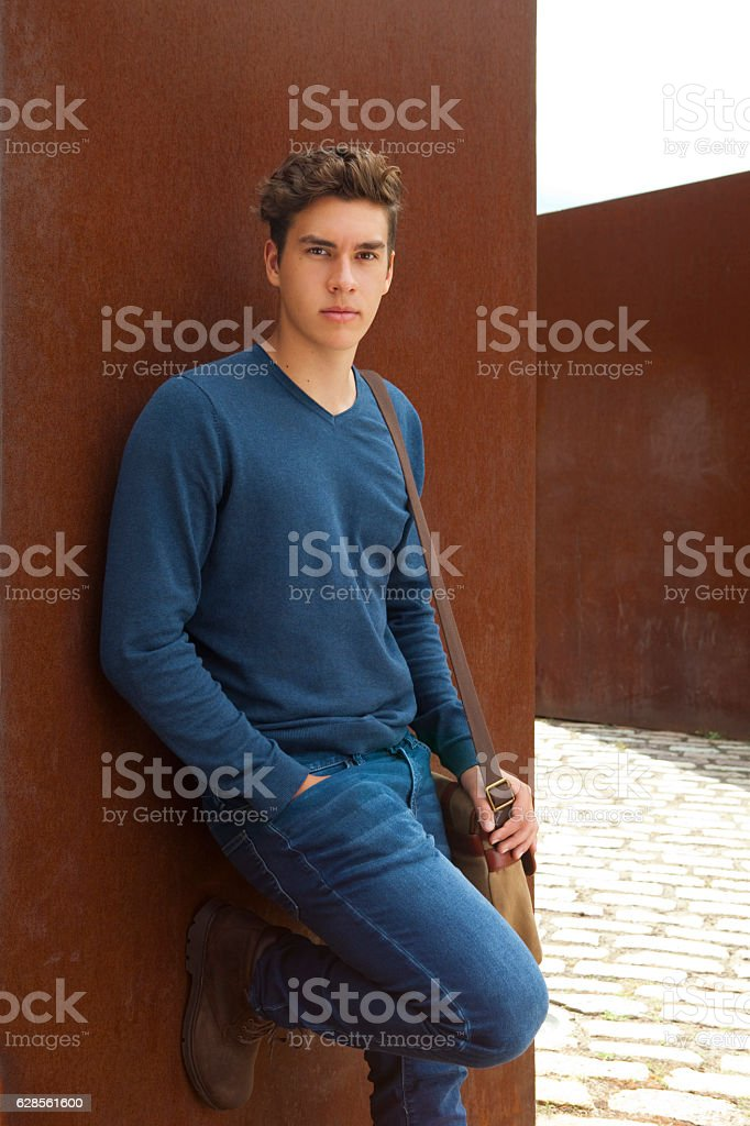 Vertical Portrait Of A Serious Young Man Outdoor stock photo