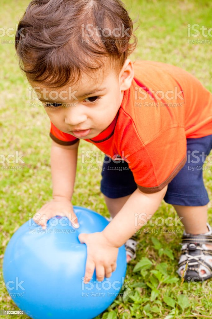Vertical Portrait of an Cheerful Asian Indian Kid Child Infant royalty-free stock photo