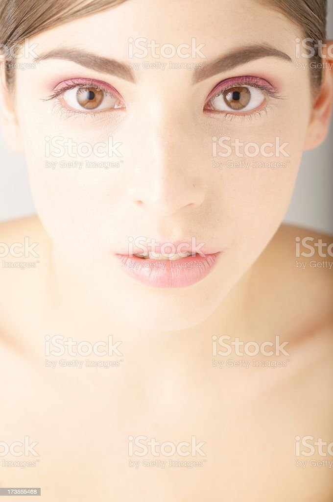 Vertical portrait of beautiful young girl with naked shoulders stock photo