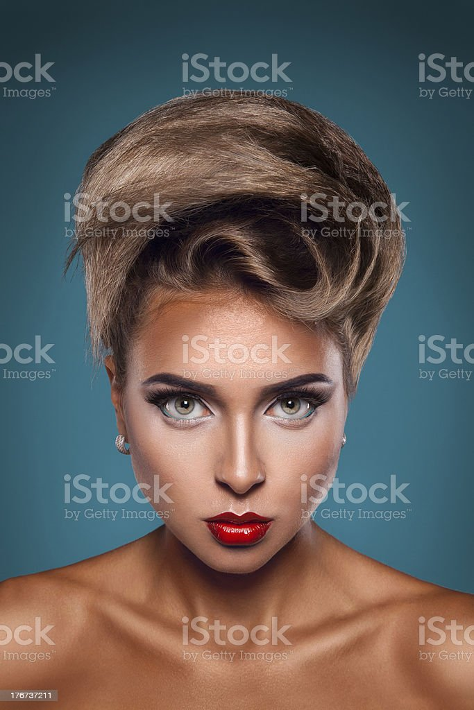 Vertical portrait of caucasian woman with unusuall hairstyle royalty-free stock photo