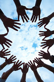 Vertical portrait of hands held in circle of unity