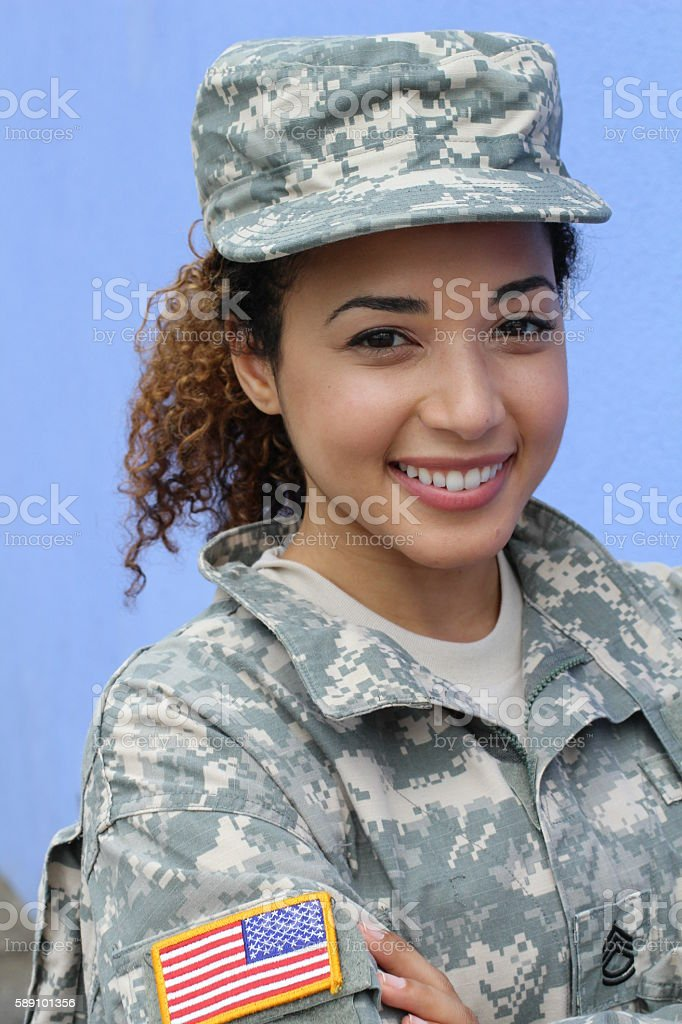 Vertical portrait of military female smiling stock photo