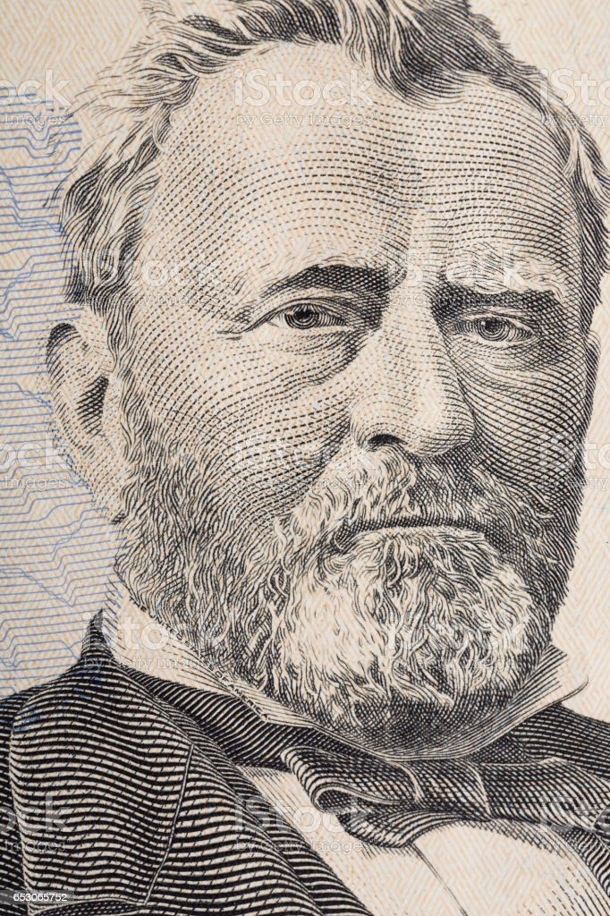 Vertical portrait of Ulysses Grant's face on the US 50 dollar bill. Macro shot stock photo