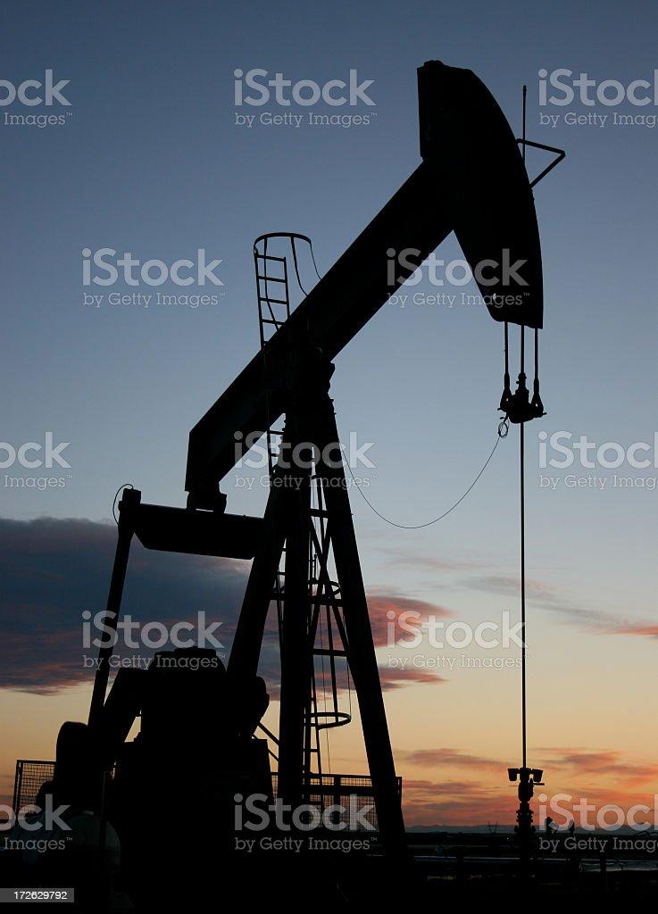 Vertical Pumpjack Silhouette in Alberta Canada Oil Industry stock photo
