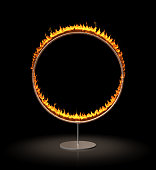 A vertical ring of fire stands against a black background