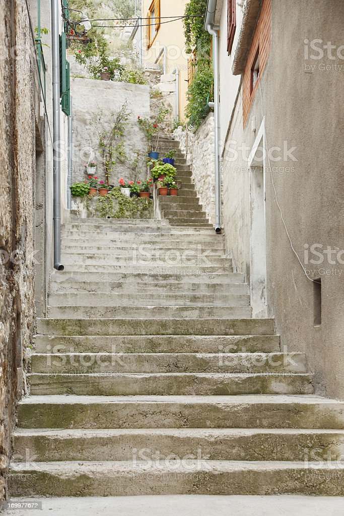 vertical rugged city cobblestone alley with stairs Croatia royalty-free stock photo