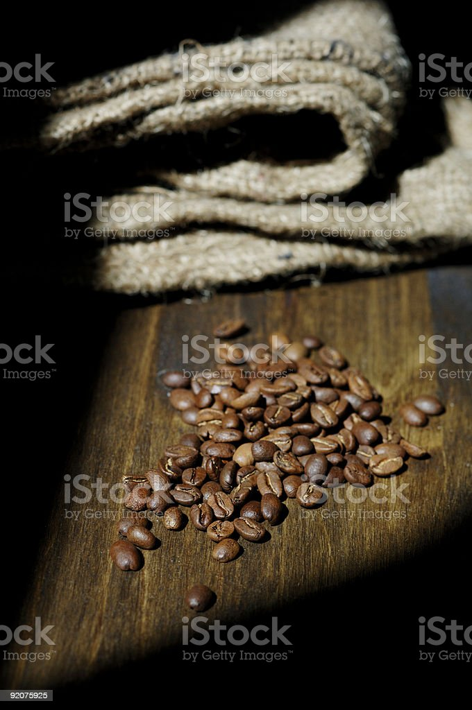 vertical rustic coffee scene, roasted beans and hessian cloth sa royalty-free stock photo