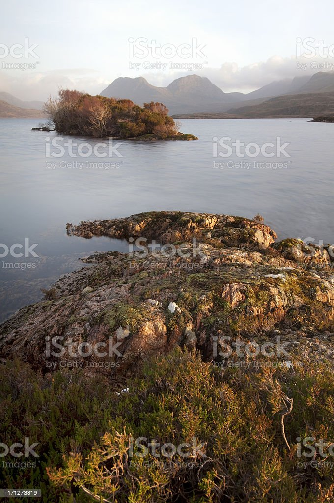 Vertical Scottish Loch in the Highlands at dusk stock photo