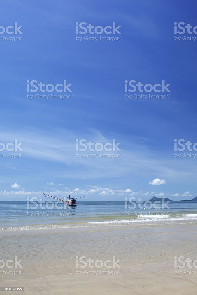 A vertical shaped photo of a beach on a sunny day royalty-free stock photo