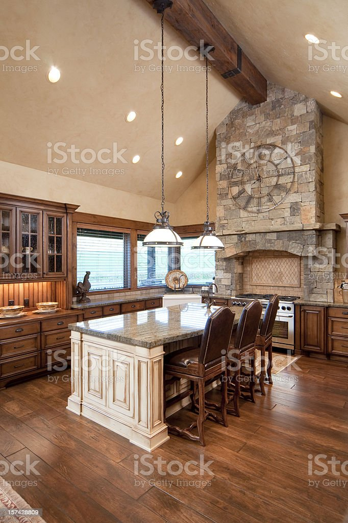 Vertical shot of a natural tone kitchen with island stock photo