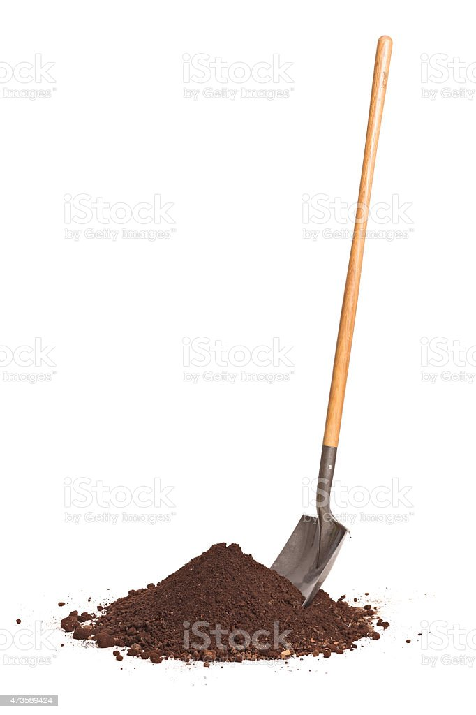 Vertical shot of shovel stuck in a pile of dirt stock photo