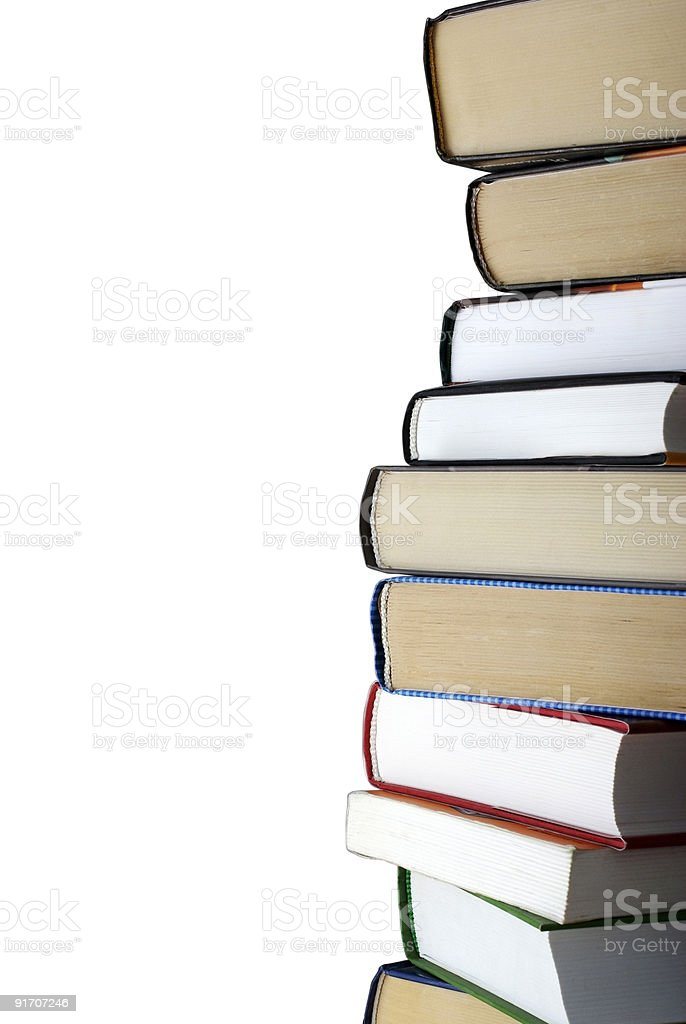 Vertical stack of different books isolated on white background. royalty-free stock photo