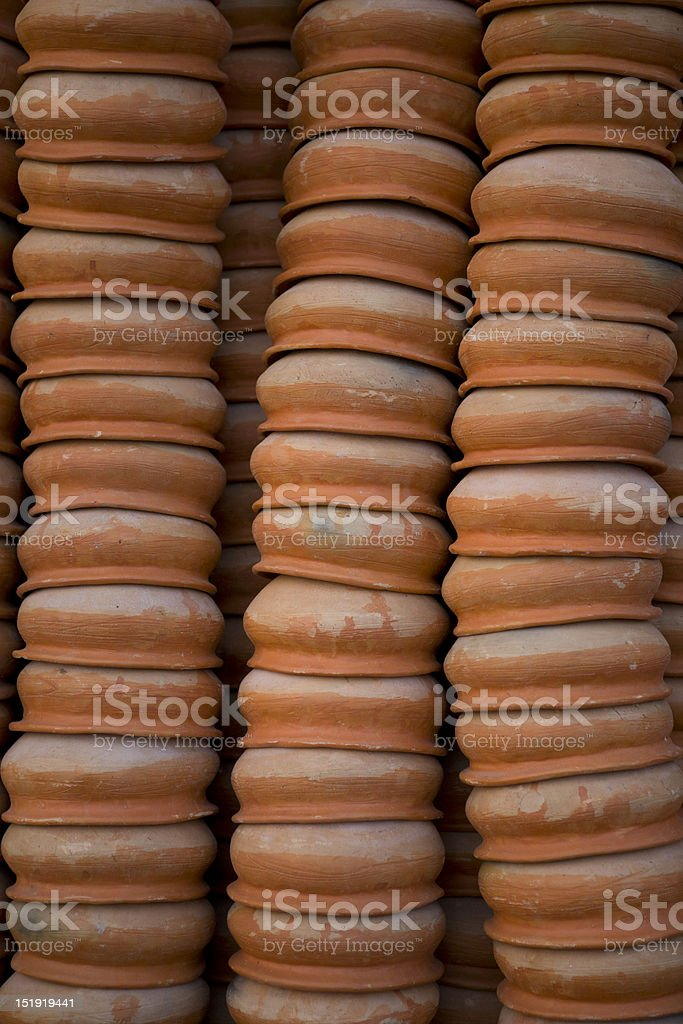 Vertical stack of layered clay pots. royalty-free stock photo