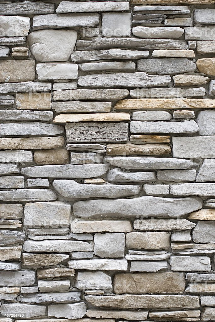 Vertical stacked stone walls royalty-free stock photo