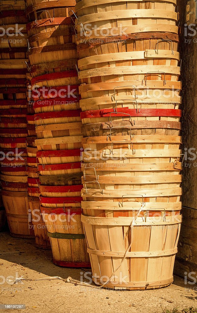 Vertical stacks of empty farm baskets stock photo