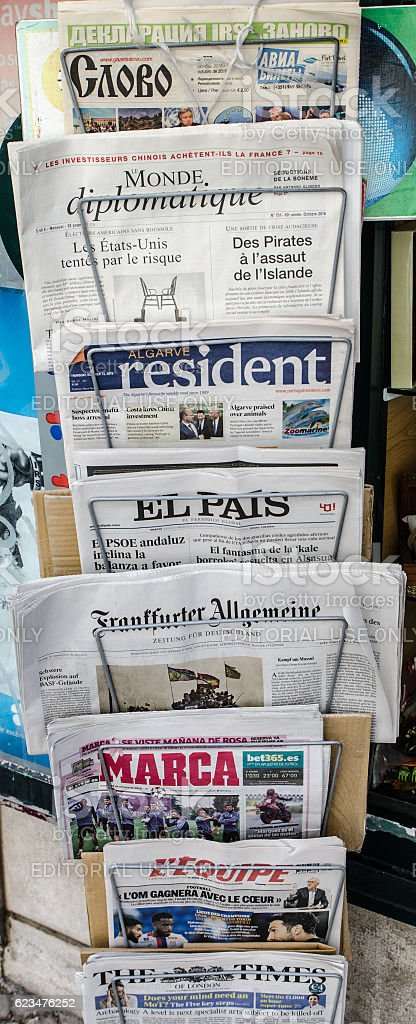 Vertical stand with international newspapers stock photo