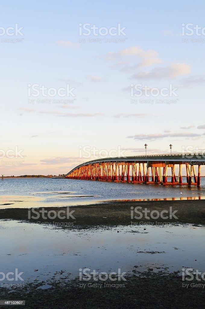 Vertical Verazano Bridge To Assateagur Island At Sunset stock photo