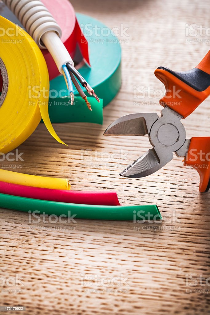 vertical view nippers electric cable rolls of isulating tape hea stock photo