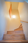 vertical view of light and wooden staircase