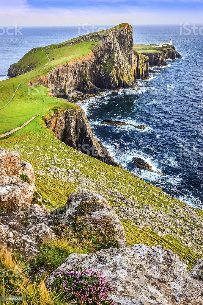 Vertical view of Neist Point lighthouse and rocky ocean coastline stock photo