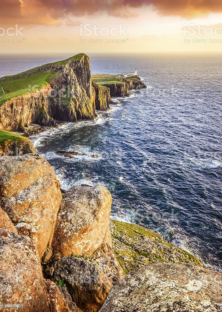 Vertical view of Neist Point lighthouse with rocks foreground, S stock photo