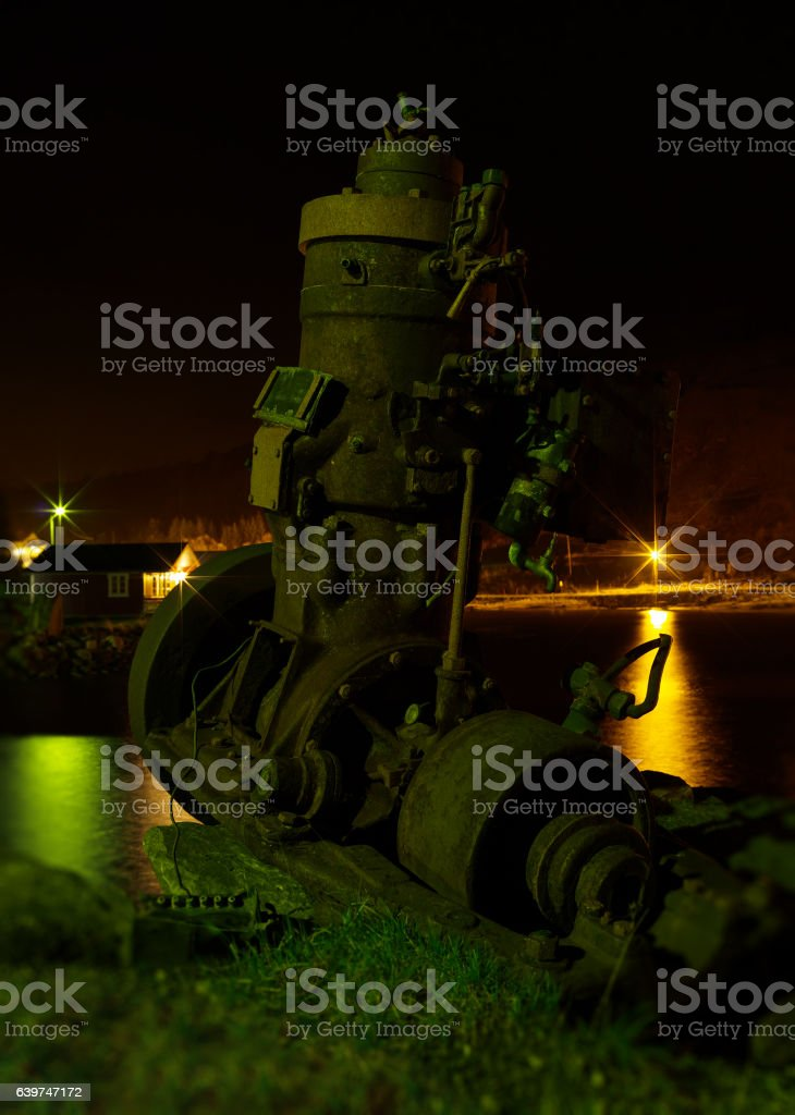 Vertical vintage ship engine on the beach bokeh background backd stock photo