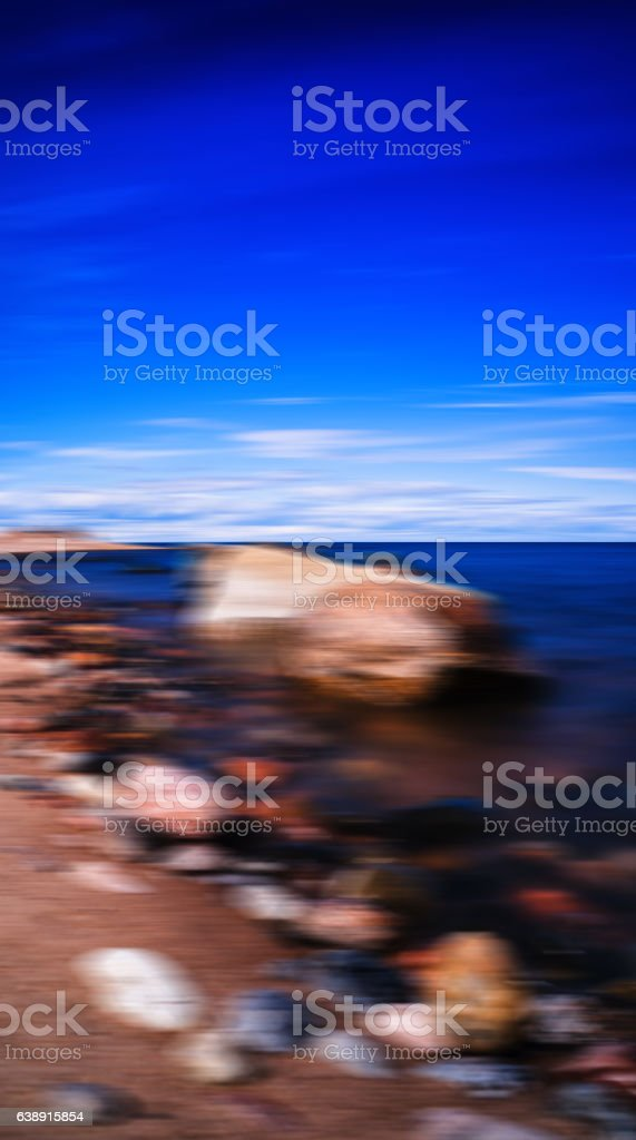 Vertical vivid stony beach motion blurred abstraction background stock photo