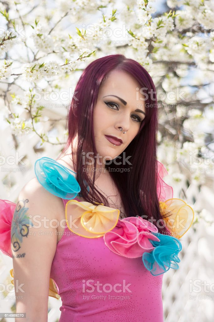 Vertical waist up image of young woman in Spring garden. stock photo