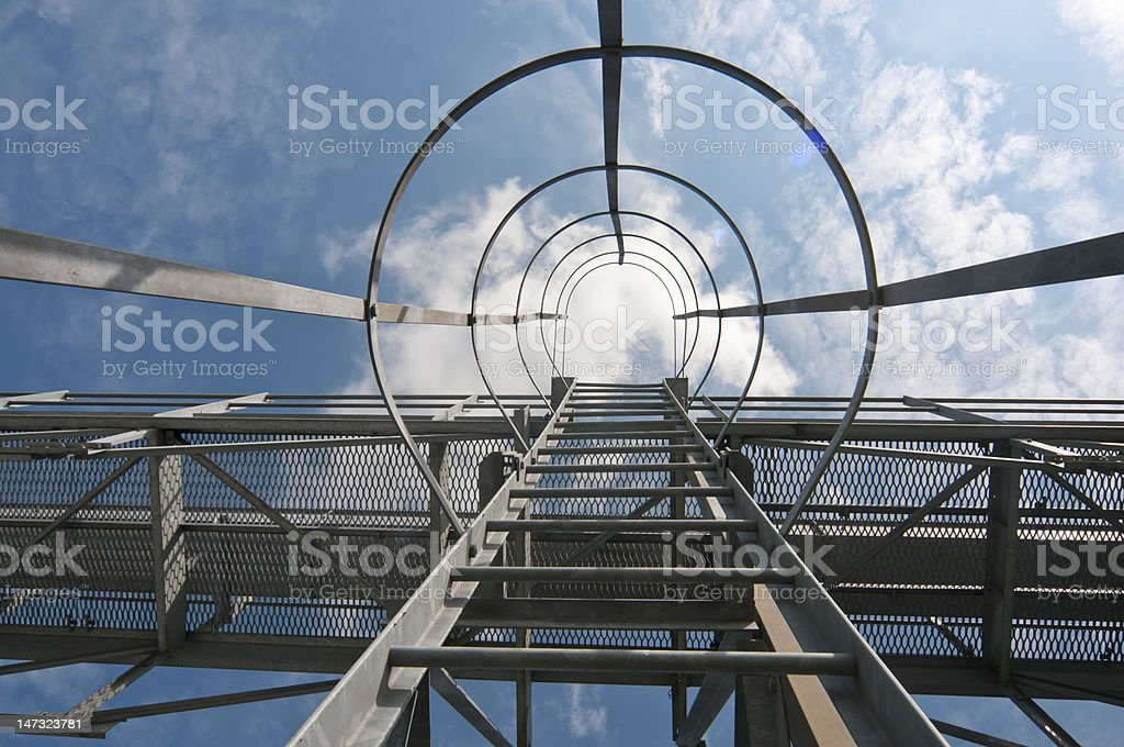 Vertical walkway ladder up grain storage silo stock photo