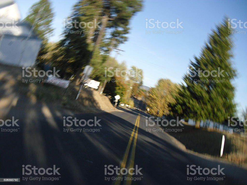 Vertigo Rural Trees with Oncoming Car stock photo