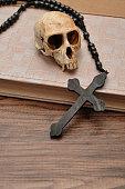 Vervet monkey skull, rosary beads, an old book