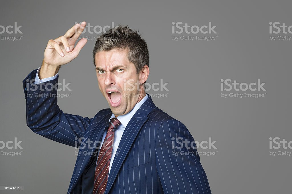 Very angry business boss shouting stock photo