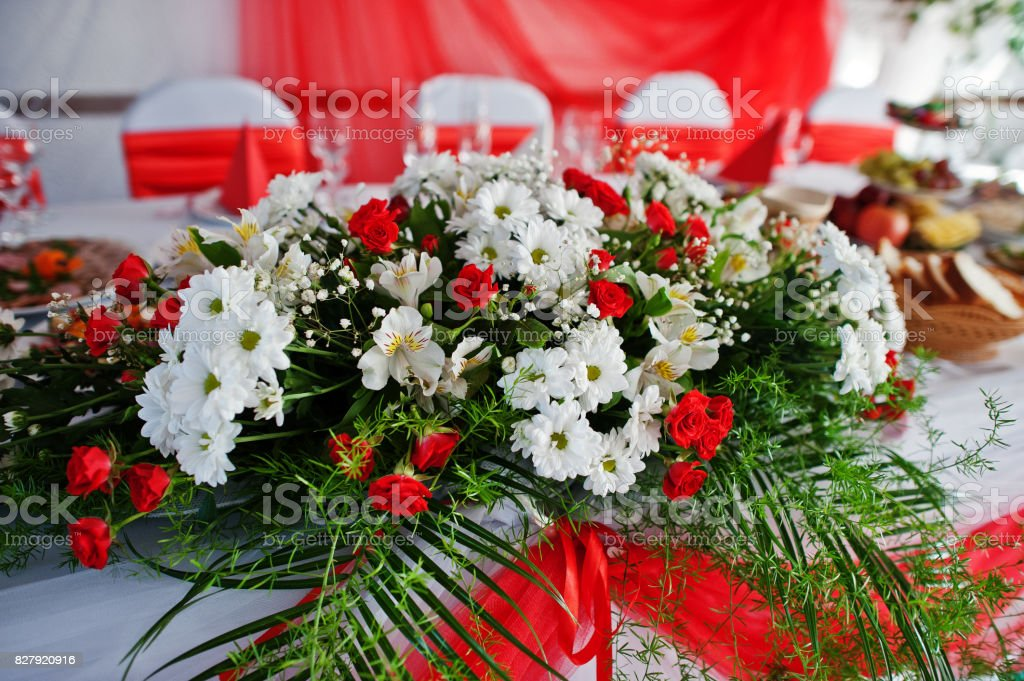 Very beautiful and gentle floral decorations on the wedding ceremony. stock photo