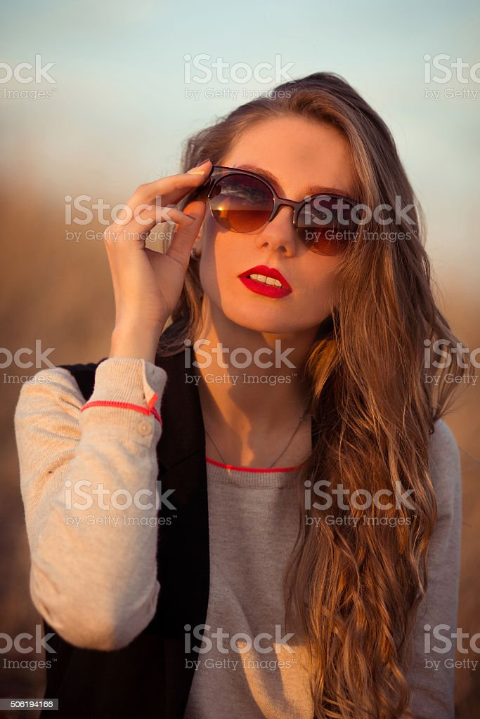 Very beautiful, attractive, snorting, fashionable, glamorous, cheerful,  girl with sunglasses. stock photo