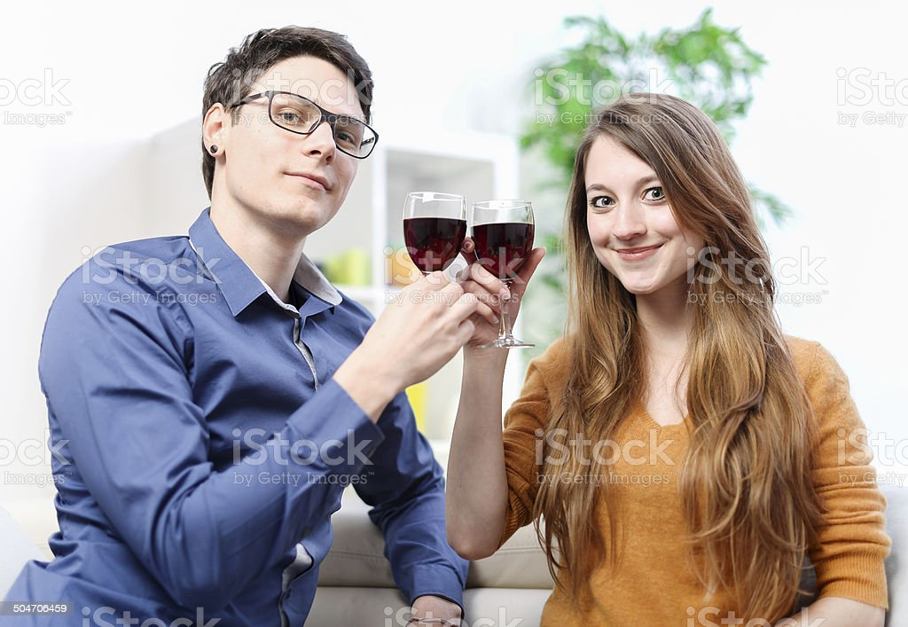 Very beautiful young couple toasting wine glasses royalty-free stock photo
