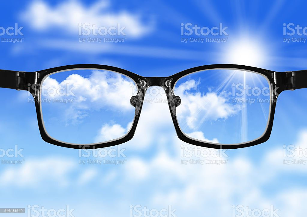 very blurry sky and glasses with blue sky stock photo