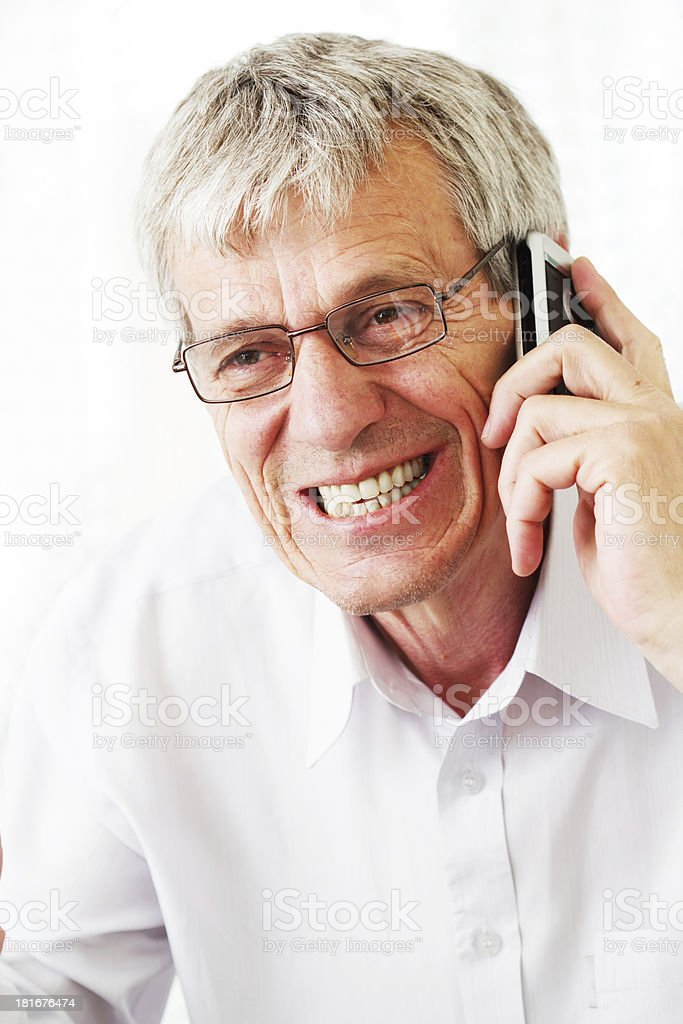 Very busy older man using a few phones royalty-free stock photo