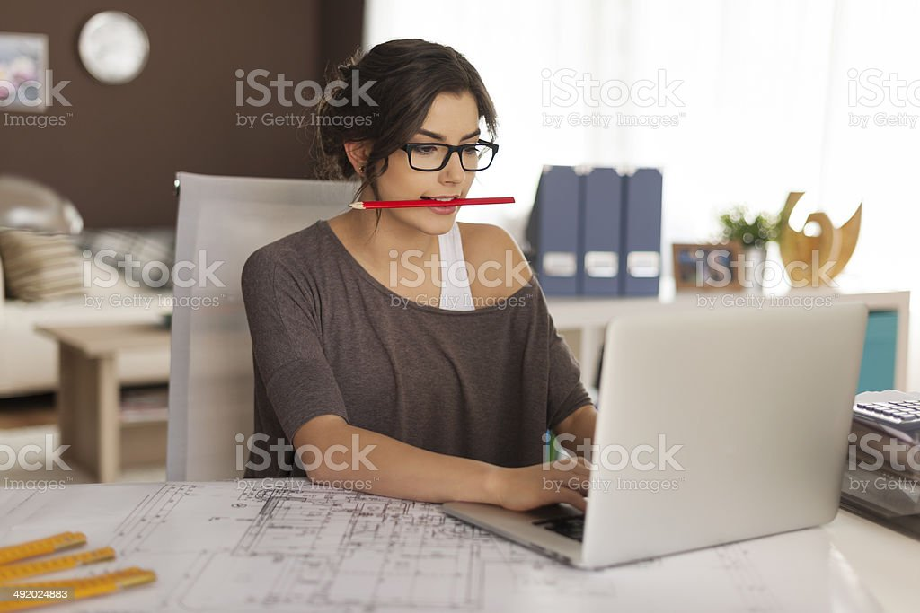 Very busy young architect working at home stock photo