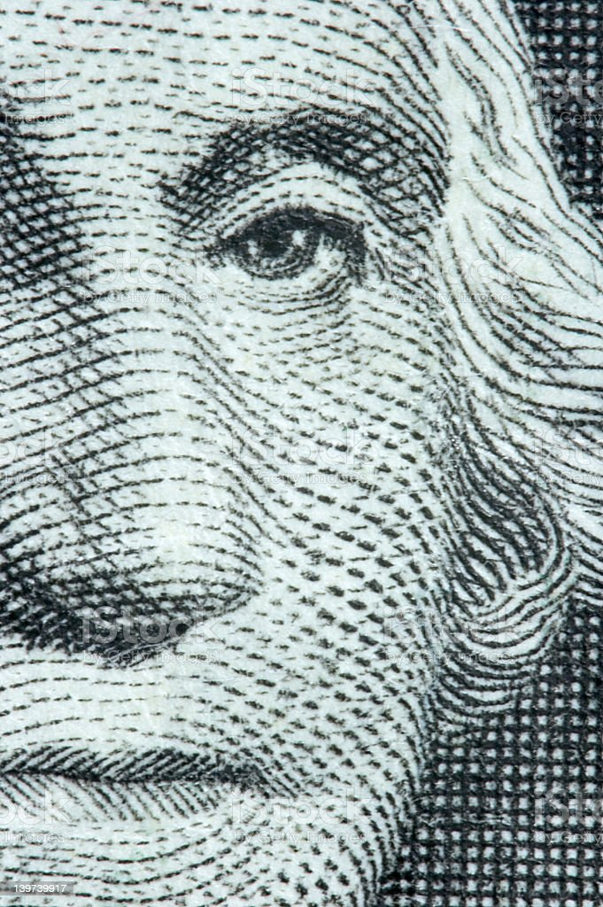 Very close-up image of George Washington on a dollar bill stock photo