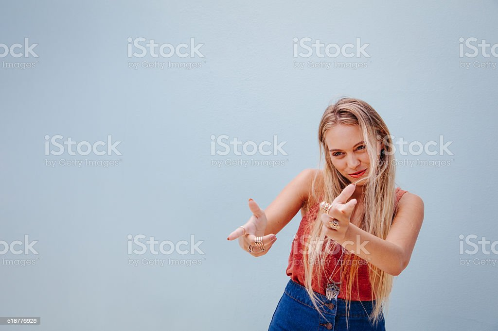 Very cool young woman goofing around stock photo