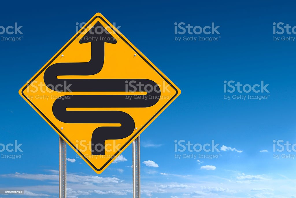 Very Curvy Road Conditions Sign Post Over Blue Sky royalty-free stock photo