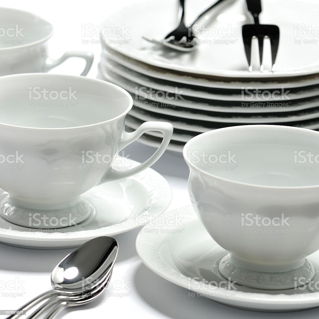 Very elegant china dessert tableware: plates, cups, spoons, forks royalty-free stock photo