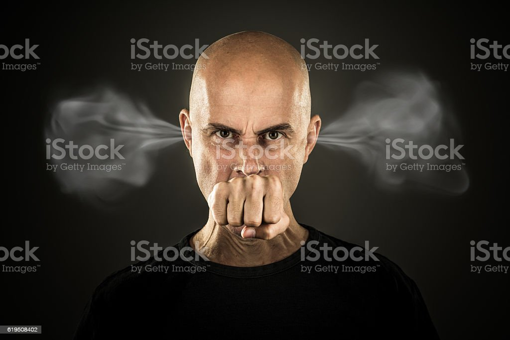 very enraged man stock photo