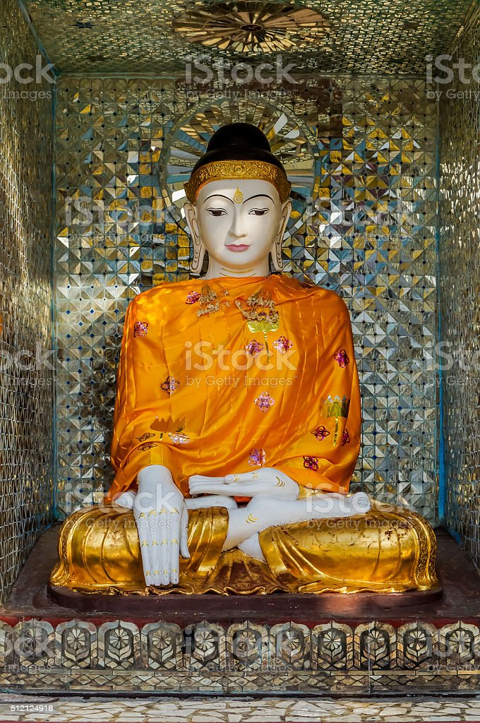 very fine Buddha in Burmese style with orange golden robe stock photo