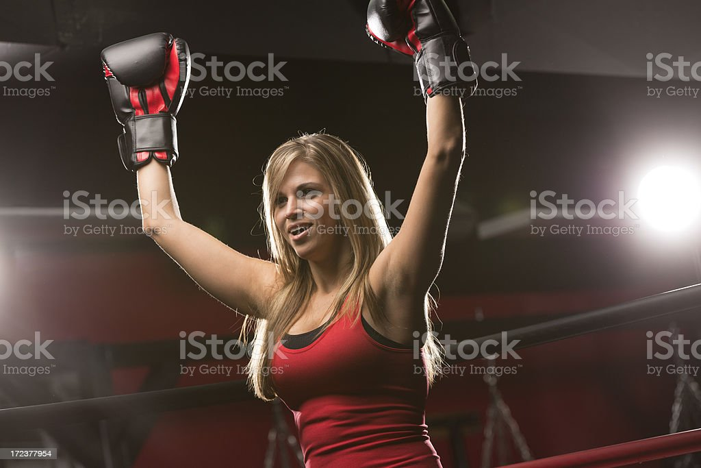 Very Fit Woman raising hands in victory royalty-free stock photo