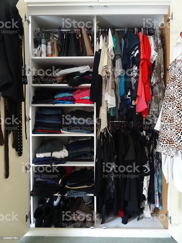 Very full wardrobe space stock photo
