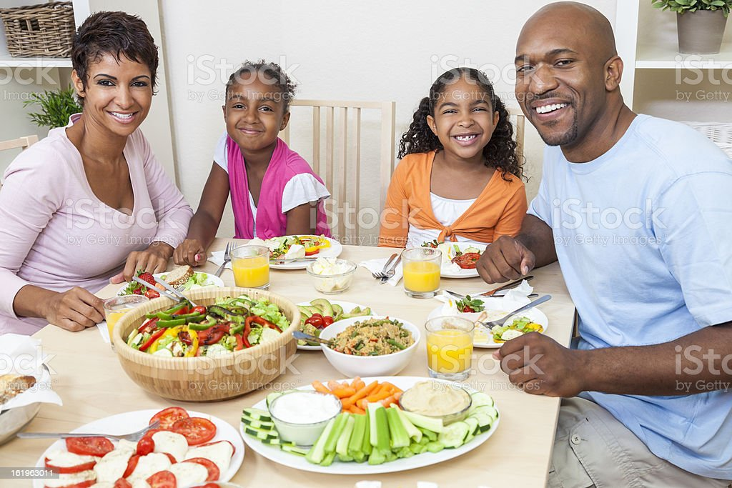 A very happy African American family at the dinner table royalty-free stock photo