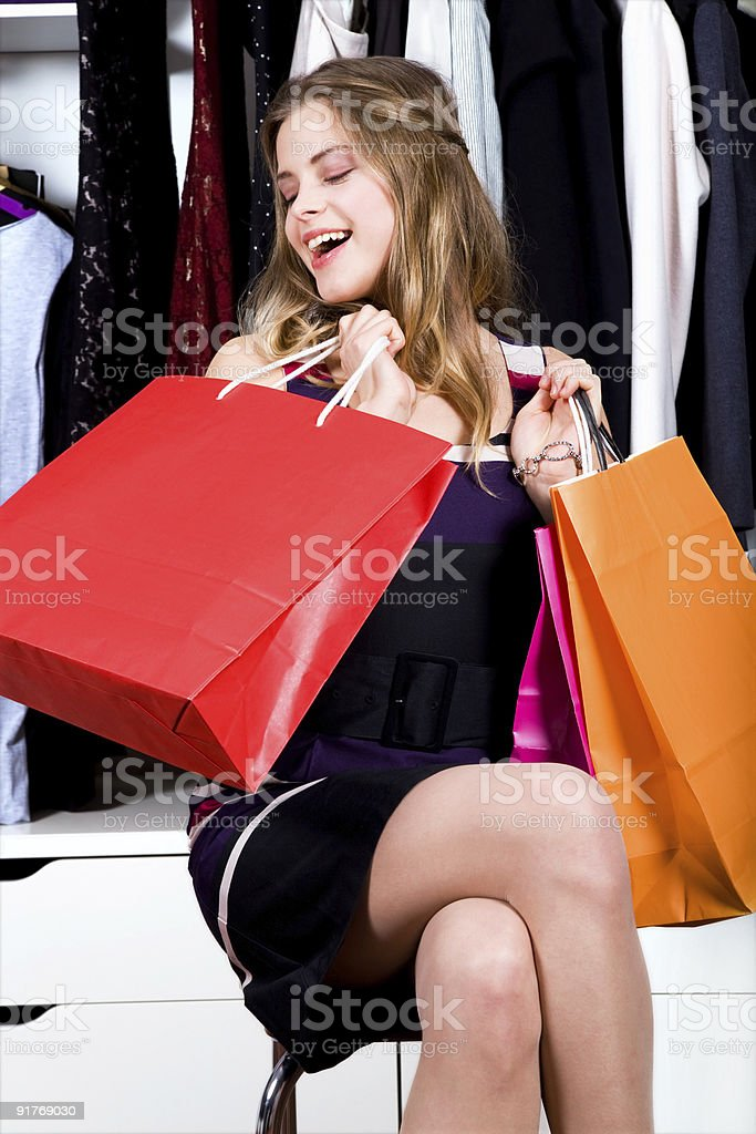 Very happy beautiful woman looking at her shopping bags royalty-free stock photo
